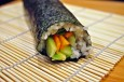 veggie sushi roll on mat