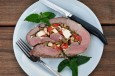 Greek leg of lamb stuffed with cheese, peppers and pine nuts
