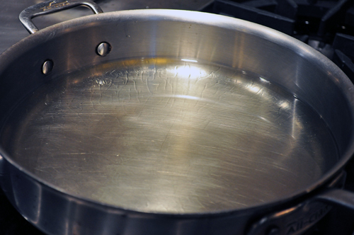 heating oil in skillet to fry fritters