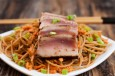 seared tuna on noodles with peanut sauce