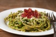 arugula pesto pasta with prosciutto chips