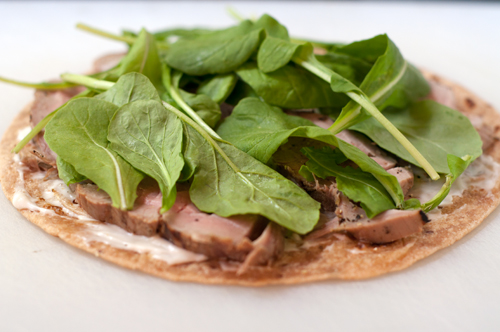 pork tenderloin and arugula on tortilla